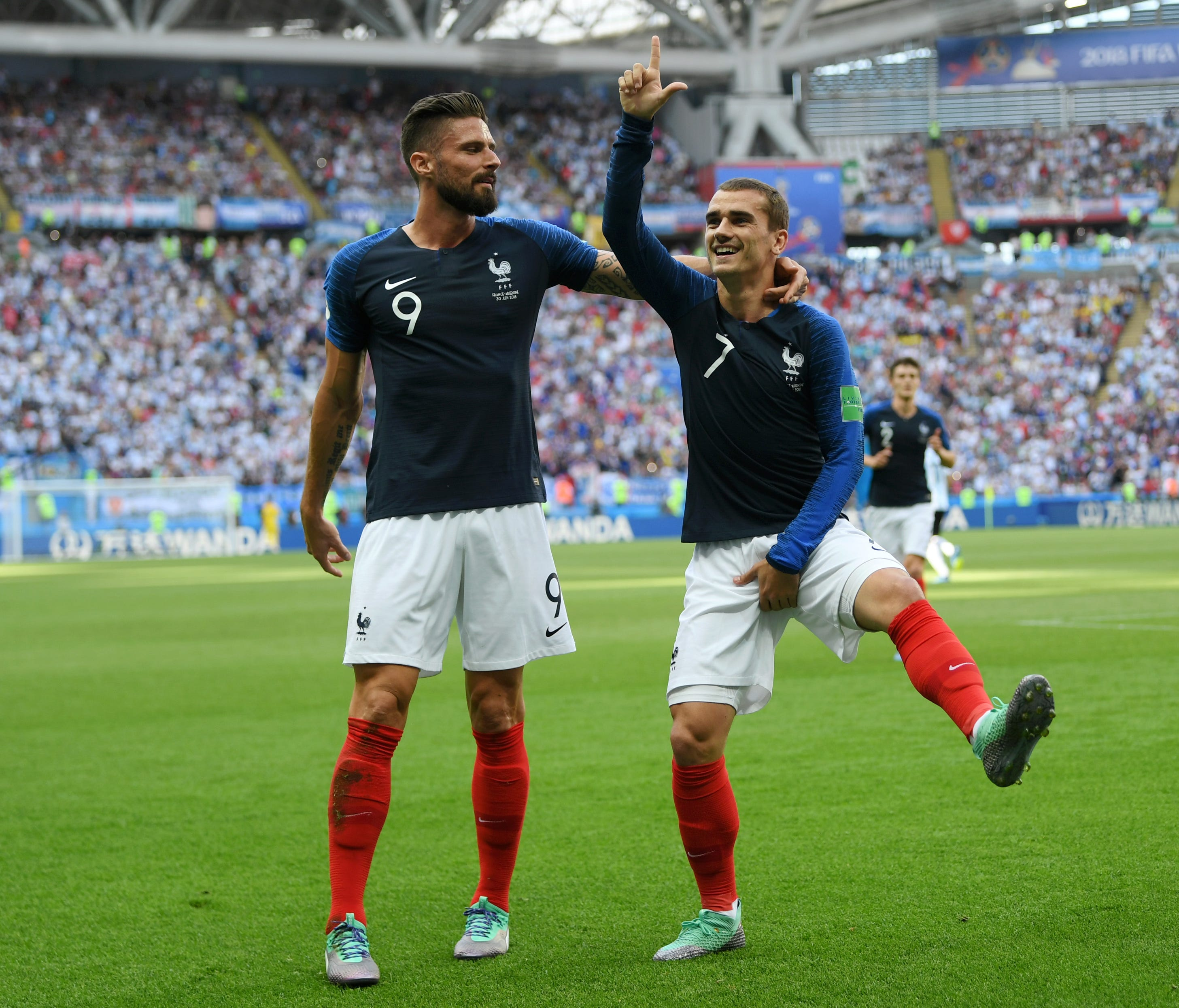 France's Antoine Griezmann celebrates with teammate Olivier Giroud after scoring his team's first goal during the 2018 FIFA World Cup Russia Round of 16 match between France and Argentina.