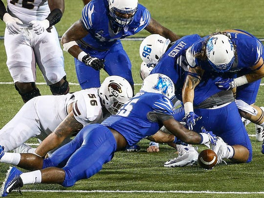 University of Memphis linebacker Bryce Huff (bottom) grabs a University of Louisiana-Monroe a fumble during second quarter action at the Liberty Bowl Memorial Stadium.