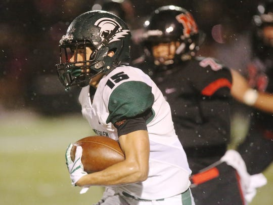 West Salem running back Anthony Gould, 15, breaks for the end zone to score a touchdown in the Titans' Greater Valley Conference game against the McMinnville Grizzlies Thursday, Oct. 12 at Wortman Stadium in McMinnville.