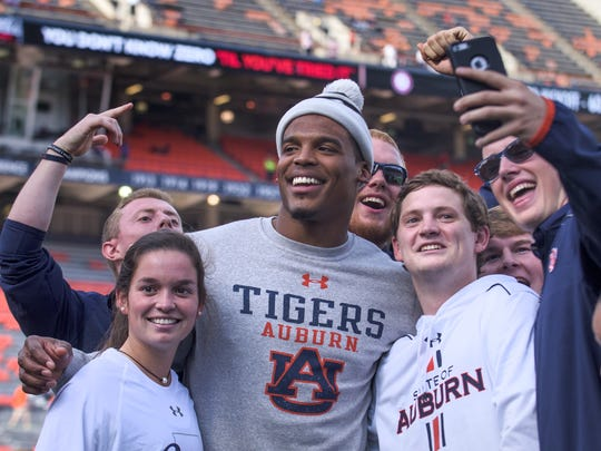 Cam Newton poses in selfies before the Iron Bowl at Jordan-Hare Stadium in Auburn, Ala. on Saturday November 28, 2015. (Mickey Welsh / Montgomery Advertiser)
