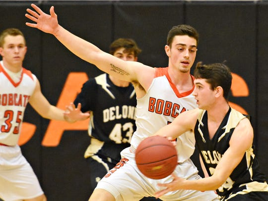 Northeastern vs Delone Catholic during Bobcat Tip-Off Classic basketball action at Northeastern High School in Manchester Township, Friday, Dec. 8, 2017. Northeastern would win the game 80-40. The Bobcats were ranked No. 7 in the state in Class 5-A by City of Basketball Love going into the 2017-18 season. Dawn J. Sagert photo