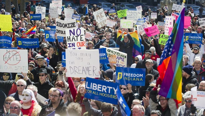 Thousands of opponents of Indiana's Religious Freedom Restoration Act gather on the lawn of the Indiana State House to rally against that legislation.