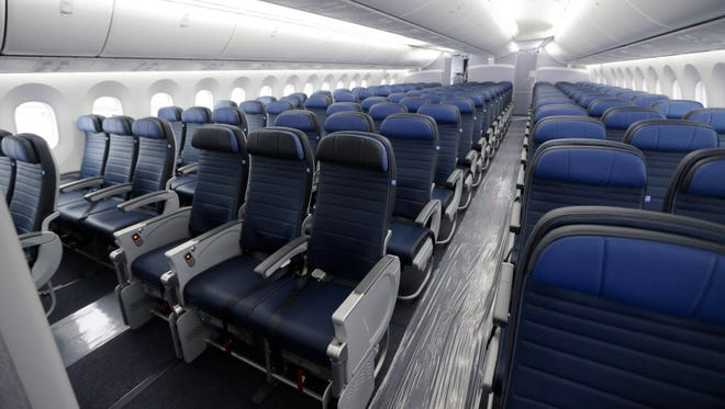 Economy class seating on a new United Airlines Boeing 787-9 undergoing final configuration Jan. 26, 2016, and maintenance work at Seattle-Tacoma International Airport in Seattle.