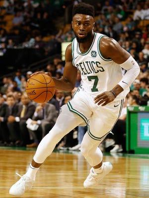 Boston Celtics forward Jaylen Brown (7) drives during the second half of the Boston Celtics' 94-80 win over the Charlotte Hornets.