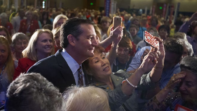 Republican presidential contender Sen. Ted Cruz poses for photos and signs autographs after speaking at the National Federation of Republican Women Convention at JW Marriott Desert Ridge Resort & Spa in Phoenix on Saturday, September 12, 2015.