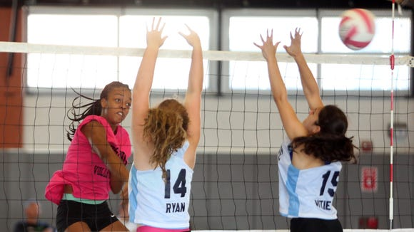 Mychael Vernon with the Ossining High School Volleyball team, returns a shot against The Ursuline School during the Breast Cancer Awareness tournament at Hendrick Hudson High School in Montrose, Sept, 10, 2016.