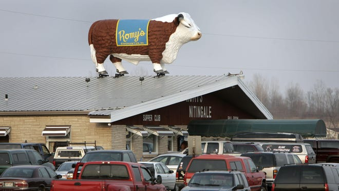 A steer stands atop the popular Romy's Nitingale in Black Creek.