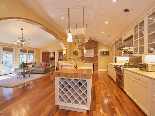 The gourmet kitchen with marble counters, rich cabinetry, and an astonishing ceramic-arched ceiling.