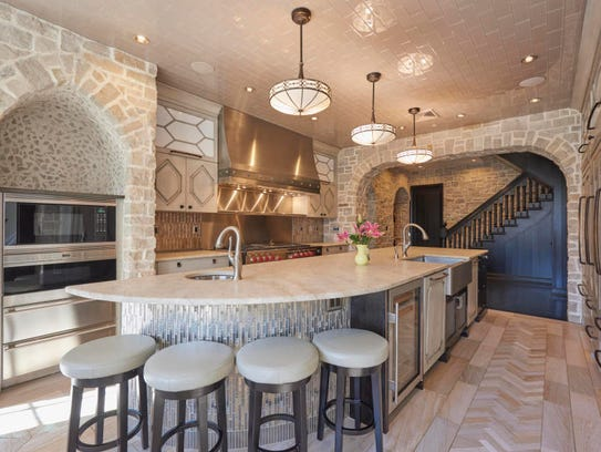 The gourmet kitchen offers a breakfast nook and stainless steel appliances.