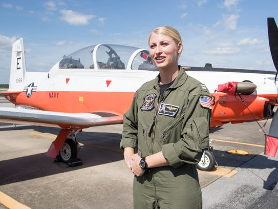 Lt. Ashley Hallford, stands in front of a T-6B Texan