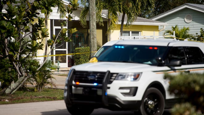 Martin County Sheriff's Office personnel work at the scene of a shooting following a dispute on the 900 block of Northwest Sunset Terrace on Friday, Jan. 12, 2018, in Martin County. The shooting occurred among people working in the area after an argument over vehicle parking, according to Sheriff William Snyder.