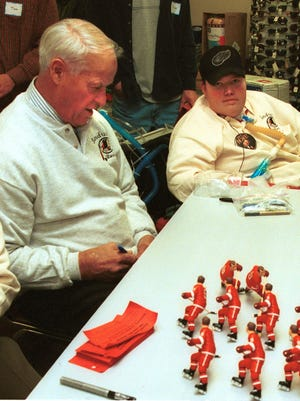 Gordie Howe meets with Sandusky's Steven Kirkpatrick, who battled muscular dystrophy, on December 22, 1999.