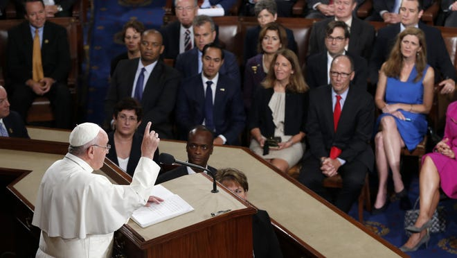 Pope Francis addresses a joint meeting of Congress on Capitol Hill in Washington, Thursday, Sept. 24, 2015, making history as the first pontiff to do so. (AP Photo/Evan Vucci)
