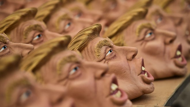 Masks representing Donald Trump are pictured in a Mexican factory last year.
