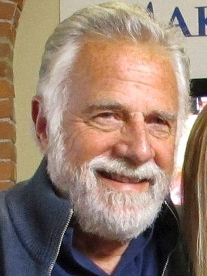 """FILE - In this March 28, 2016 file photo, Jonathan Goldsmith works on a public service announcement at the Make-A-Wish Vermont office in Burlington, Vt. Goldsmith, who appeared for nine years as the """"Most Interesting Man in the World,"""" in Dos Equis beer commercials, will return to Burlington on Saturday, March 18, 2017, to help judge a best beard contest to support the Vermont chapter of the Make a Wish Foundation."""