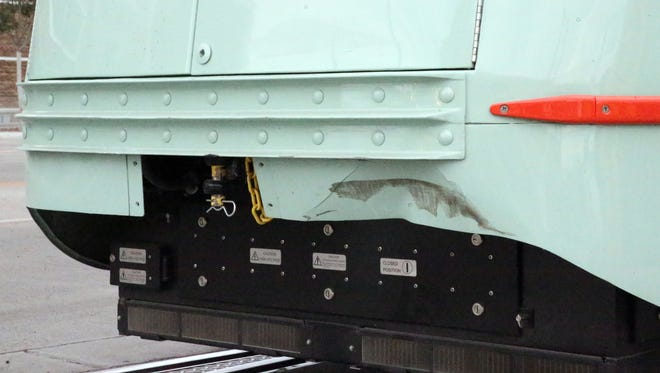 Minor damage is seen in the rear right hand corner of streetcar 1506 Tuesday.