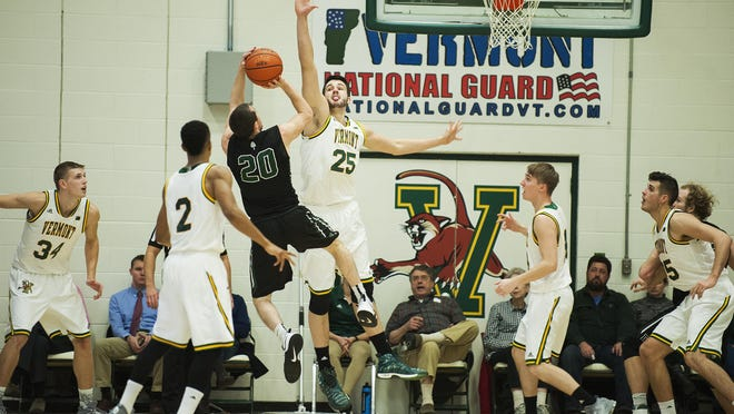 Vermont's Drew Urquhart (25) blocks the shot by Dartmouth's Mike Fleming (20) during the men's basketball game between the Dartmouth Big Green and the Vermont Catamounts at Patrick Gym on Wednesday December 7, 2016.