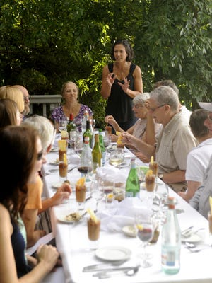 Linda Vendome of Bellavita speaks with guests at a Farm to Fork dinner, in which most of the ingredients used come from the farm. Cafe Bellavita has partnered with Taylor's River Side Farm, the next event is Sept 21 at the Cinnaminson farm.