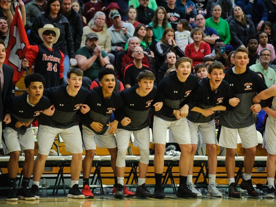 The Rutland bench watches the action on the court in