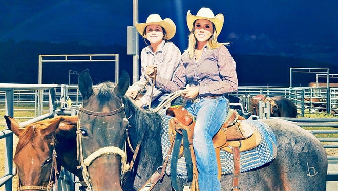 A few cowgirls pose for the camera during the Junior Rodeo at the Buster Shelley Arena during Wednesday's Grant County Fair action.