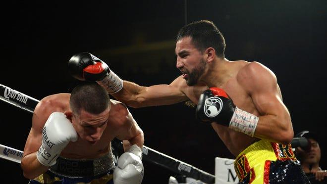 Ronny Rios, left, fights Jayson Velez at Mandalay Bay Events Center. (Joe Camporeale, USA TODAY Sports)