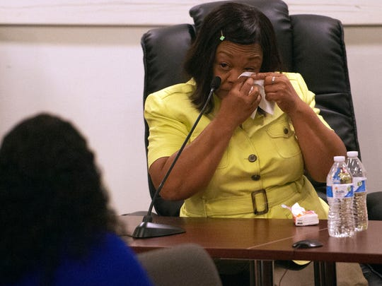 Sandra Harrison wipes her eyes after testifying during