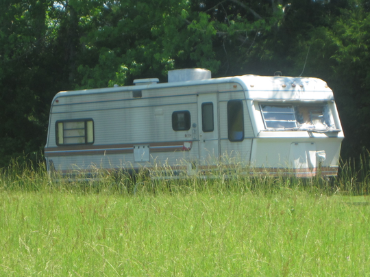 Damaged trailer on property where Felix Vail lived in 2012 in the Montpelier community, a half hour north of Starkville, Miss.