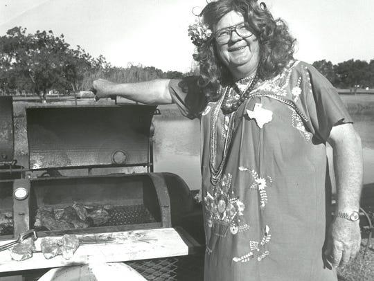 "Johnny Hampton, dressed as ""Paprika Patty,"" keeps an"
