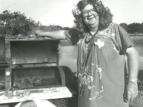 """Johnny Hampton, dressed as """"Paprika Patty,"""" keeps an eye on some fajita meat at the Steak of the Arts Cook-Off in 1991 at the Wichita Falls Museum and Art Center, now called the Wichita Falls Museum of Art at MSU. The museum will celebrate its 50th anniversary beginning in April with a Spring Fling exhibit and more."""