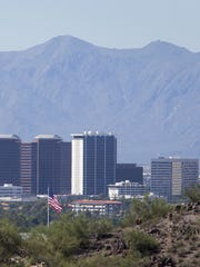 A University of Arizona economist says Arizona's healthy job growth is likely to continue through 2020.