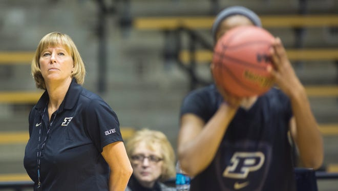 FILE - Purdue coach Sharon Versyp watches her team during practice for the first round of the NCAA Women's Basketball Championship  March 21, 2014.