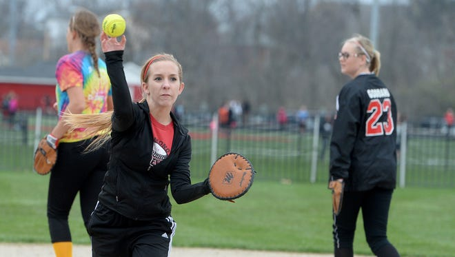 Richmond High School softball players Emily Malone throws a ball during practice Wednesday, March 23, 2016, at Richmond.