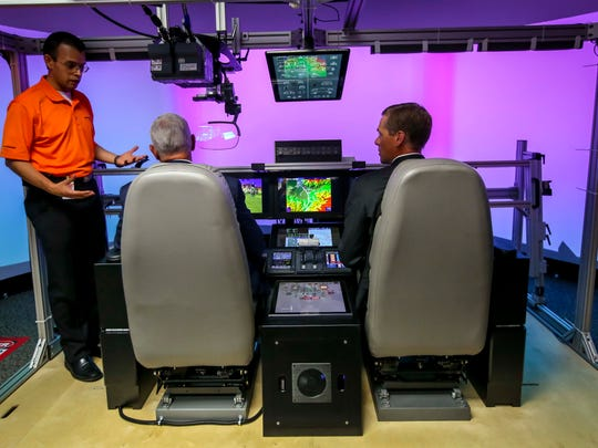 Vice President Mike Pence is given a tour of a flight systems simulator Wednesday, July 11, 2018, at Rockwell Collins in Cedar Rapids Iowa.