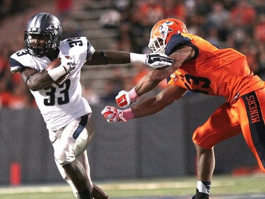 Old Dominion running back Ray Lawry runs around UTEP's Roy Robertson-Harris during their NCAA football game Saturday, Oct. 11, 2014, at the Sun Bowl in El Paso, Texas.