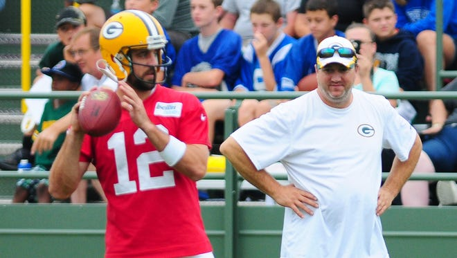 Green Bay Packers quarterbacks coach Alex Van Pelt watches Aaron Rodgers throw during training camp practice at Ray Nitschke Field.
