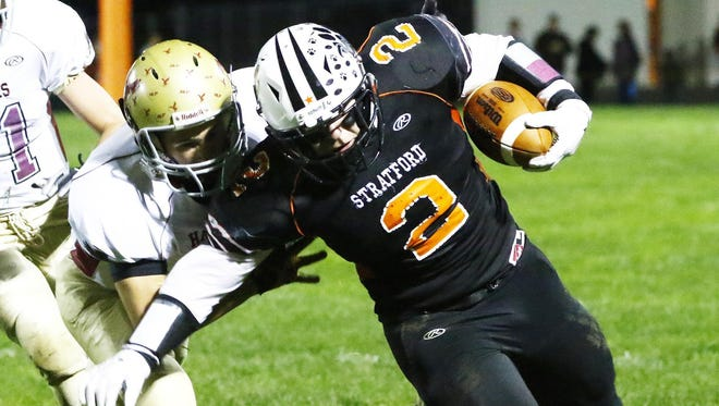 Stratford's Kamren Bornbach(2), right, avoids being tackled by Prentice/Rib Lake's Chase Swan(7) during a game last season at Tiger Stadium in Stratford.