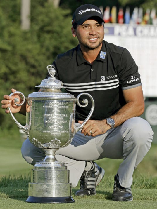 Jason Day posses with the Wanamaker Trophy after winning the PGA Championship on Sunday at Whistling Straits in Haven, Wisconsin.