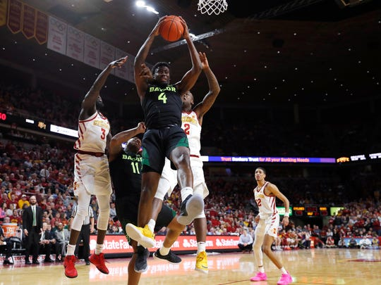 Baylor guard Mario Kegler, center, pulls down a rebound during the second half of the team's NCAA college basketball game against Iowa State, Tuesday, Feb. 19, 2019, in Ames, Iowa. Baylor won 73-69. (AP Photo/Matthew Putney)