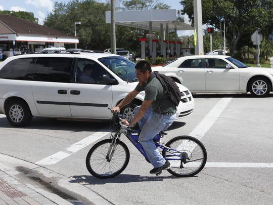 Bicyclist Milton Valey crosses Terry Street in the crosswalk at the intersection of Terry Street and Old U. S. 41 in Bonita Springs.