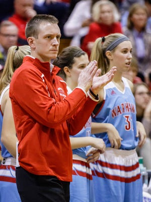 Arrowhead girls varsity basketball coach Rick Witte applauds his team during the game at Oak Creek on Friday, Nov. 17, 2017.
