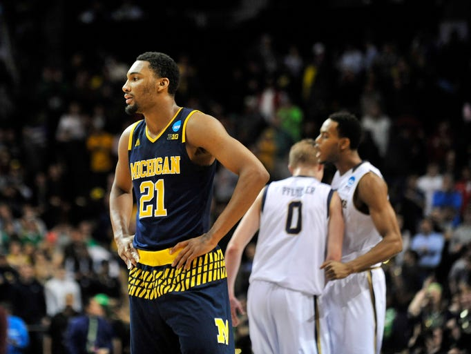 Michigan guard Zak Irvin (21)  watches near the end