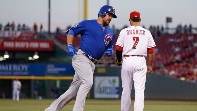 Chicago Cubs' Kyle Schwarber runs the bases after hitting a three-run home run off Cincinnati Reds starting pitcher Asher Wojciechowski during the fourth inning.