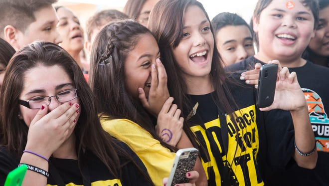 """Greenway Middle School, students, from left to right, Analicia Ramos, Maria Saavedra and Autumn Barrett all member of """"No Place For Hate"""" laugh while they watch boys break dancing during World Kindness Day on Nov 13, 2014."""