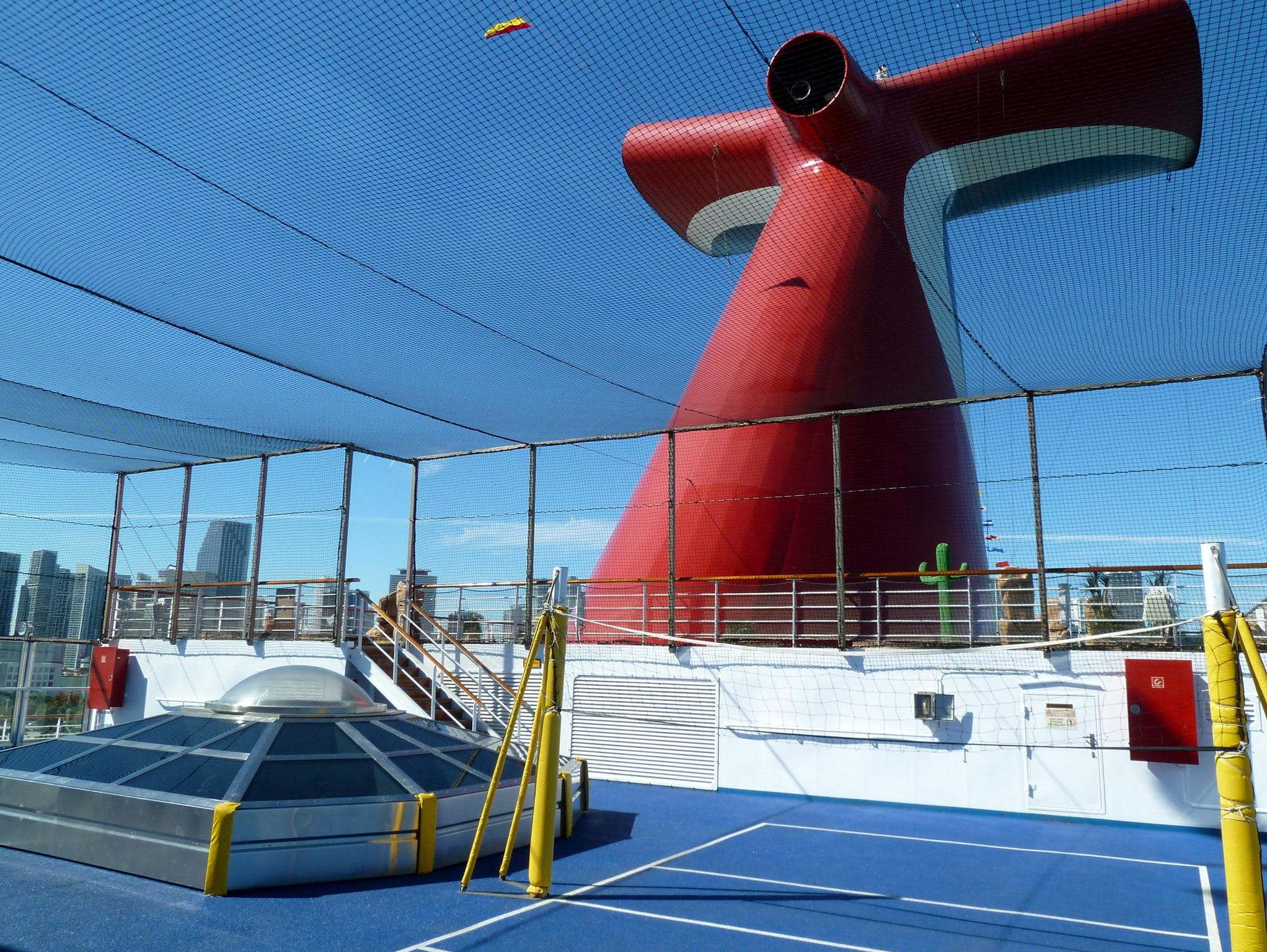 A net-enclosed basketball and volleyball court is sandwiched by the observation deck and the mini-golf course in between aft Decks 12 and 11.
