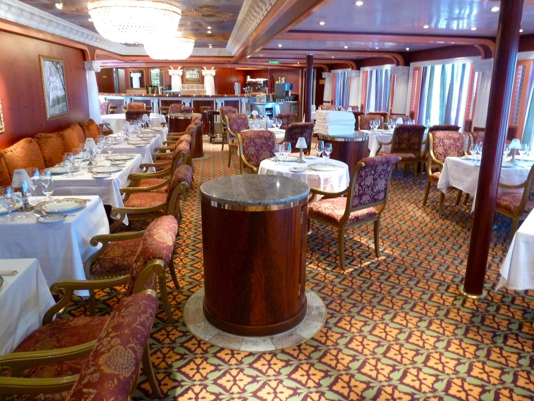 "Named for Scarlett O'Hara, Scarlett's Steakhouse is an extra-tariff, reservations-required, 108-seat dining venue on aft Deck 11. Designed with a Southern-plantation flourish, a large mural near the dance floor depicts the famous dance scene from ""Gone With The Wind."""