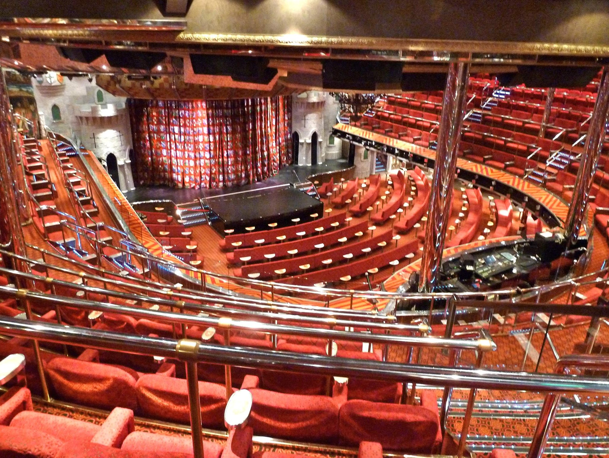 The Ivanhoe Theater is the Carnival Valor's 1,400-seat main show lounge on forward Decks 5 to 3. Decorative touches include giant knights, tapestries and faux wood beams with ornate inscriptions.