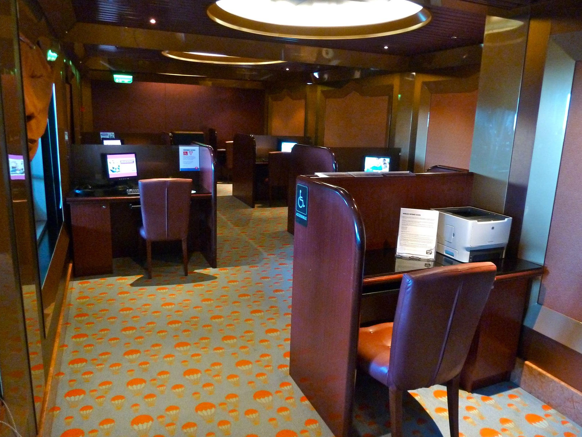 The Web internet cafe is accessed from the port side of Winston's Cigar Bar on Deck 4.