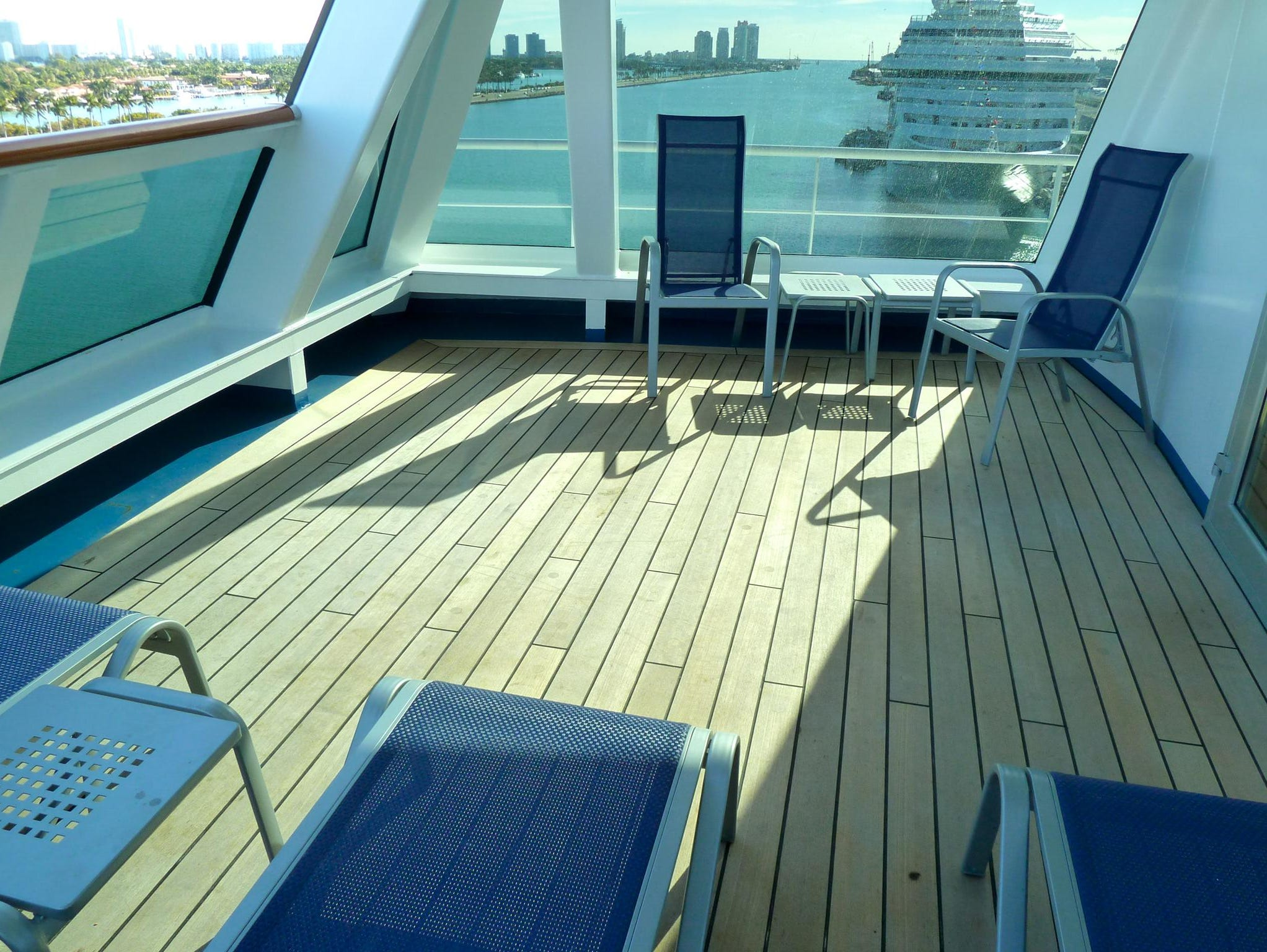Captain's Suite balconies extend over the bridge wings and are sheltered from the wind by a full-length glass screen.