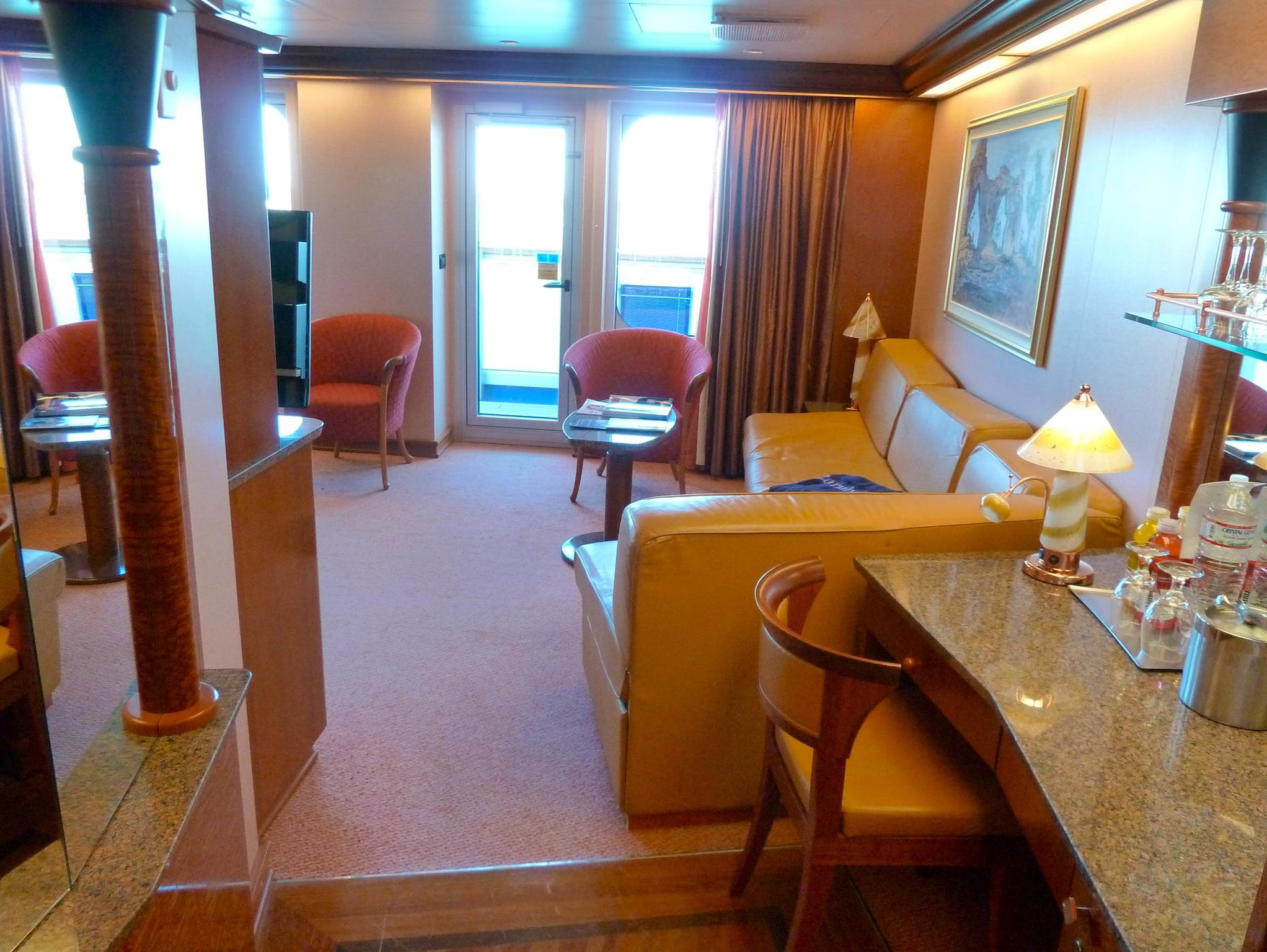 There are 10 Grand Suites on the Carnival Valor. This view shows the entryway and living room areas.