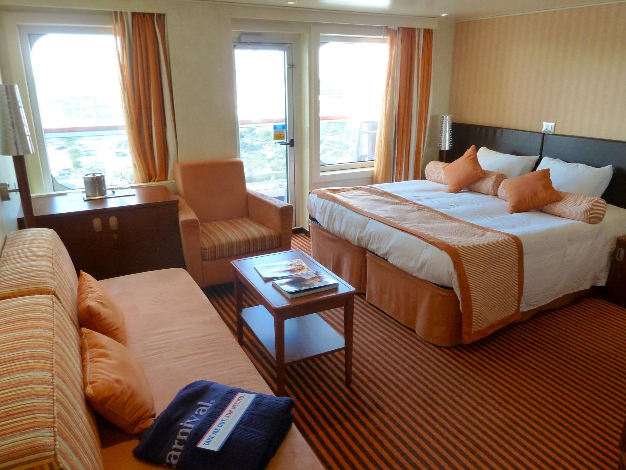 Two Junior Suites on forward Deck 9 are slightly smaller but similarly configured to the Grand Suites with a comfortable combined sitting area and bedroom.